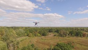 Drone copter UAV - aerial video shooting flying on eight propellers oktocopter. stock video footage