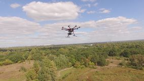 Drone copter UAV - aerial video shooting flying on eight propellers oktocopter. Video capture of professional oktocopter in the air with help of the other stock video footage