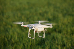 Drone. Decent view of a drone flying over a field stock images