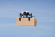 Drone delivering box package on delivery flight royalty free stock photography