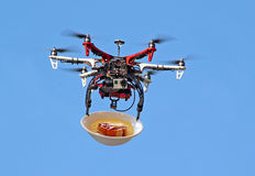 Drone delivering meals Royalty Free Stock Image