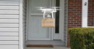 Drone Delivers Package to Home stock footage