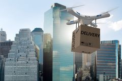 The drone delivery concept with box in air. Drone delivery concept with box in air Royalty Free Stock Photos
