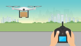 Drone delivery concept. Drone carrying cardboard box with remote Royalty Free Stock Images