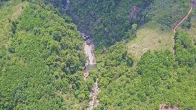 Drone Descends to River Waterfall among Green Highland stock video