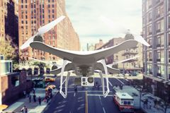 Drone with digital camera flying in a bigh city Stock Photography