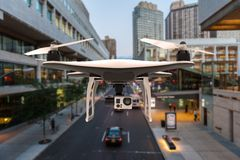 Drone with digital camera flying in a city Stock Image