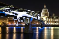 Drone with digital camera flying on an European famous city. 3D rendering Royalty Free Stock Photography