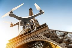 Drone with digital camera flying over Tour Eiffel. 3D rendering Stock Photo