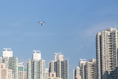 Drone doing surveillance take aerial photographs over cityscape Royalty Free Stock Photography