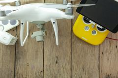 Drone equipment with Remote control on old wooden background, copy space for your text Top view image, flat lay composition.  stock photography