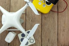 Drone equipment with Remote control on old wooden background, copy space for your text Top view image, flat lay composition.  stock image