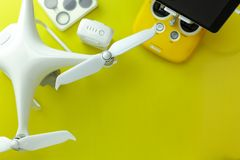 Drone equipment with Remote control on yellow paper background, copy space for your text Top view image, flat lay composition.  stock photography
