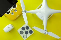 Drone equipment with Remote control on yellow paper background, copy space for your text Top view image, flat lay composition.  royalty free stock photos