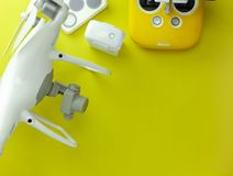 Drone equipment with Remote control on yellow paper background, copy space for your text Top view image, flat lay composition.  stock images