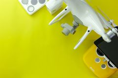 Drone equipment with Remote control on yellow paper background, copy space for your text Top view image, flat lay composition.  stock photos