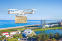 Drone fast delivery concept, multicopter flying with cardboard b Royalty Free Stock Images