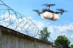 The drone flew across the sky with smuggling. The drone transports forbidden goods across the border breaking the law. Delivery of