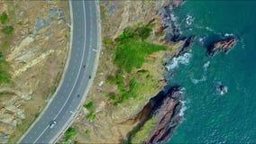 Drone Flies around Coastal Highway Turn by Azure Ocean stock video footage