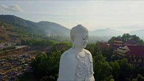 Drone Flies around White Buddha Statue against Temple stock footage
