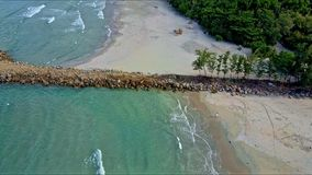 Drone Flies from Azure Sea Close to Sand Beach with Pier stock video