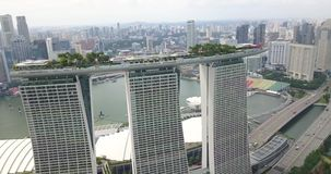 Aerial footage of the Marina Bay Sands hotel and panorama of Singapore stock video footage