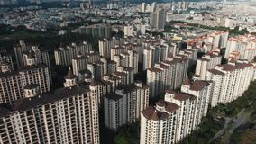 Modern residential area of Guangzhou. The drone flies on a modern residential area of Guangzhou where there are many buildings among the green trees. China stock video footage