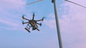Drone flies near the wind turbine, slow motion. stock footage