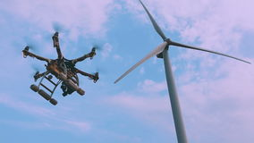 Drone flies near the wind turbine, slow motion. stock video
