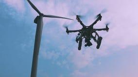 Drone flies near the wind turbine, slow motion. stock video