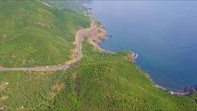Drone Flies from Ocean Coast along Highway and above Hills stock video footage