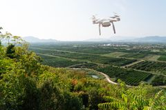 Drone flies over agricultural valley stock photography