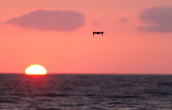 Drone flies over a colourful sunrise sky. Stock Photo