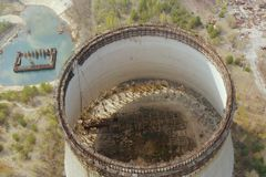 Drone flies over the cooling tower, top view stock images