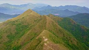 Drone Flies Slowly over High Brown Peaks of Mountain Ridge stock footage