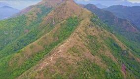 Drone Flies Slowly over Huge Brown Mountain Ridge stock footage