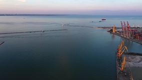 Drone flies to Odessa Seaport from the Potemkin Steps and city centre. 4K stock footage