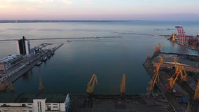 Drone flies to Odessa Seaport from the Potemkin Steps and city centre. 4K stock video
