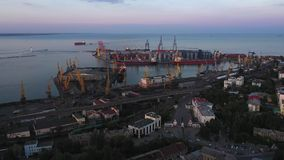 Drone flies to Odessa Seaport from the Potemkin Steps and city centre. 4K stock video footage