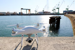 Drone before the flight on concrete blocks. KAGAWA, JAPAN - MAY 28, 2017: White drone Dji Phantom4Pro stay on concrete blocks for protection of port and ready to Royalty Free Stock Photos