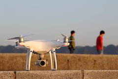 Drone before the flight on concrete brick. KAGAWA, JAPAN - APRIL 29, 2017: White drone Dji Phantom4Pro stay on concrete brick and ready to fly Stock Images