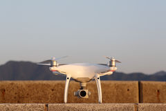 Drone before the flight on concrete brick. KAGAWA, JAPAN - APRIL 29, 2017: White drone Dji Phantom4Pro stay on concrete brick and ready to fly Stock Photography