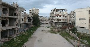 A drone flight on a destroyed city. Of Syria stock video footage