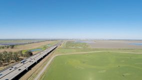 Drone Flight In Field Next To Freeway With Sacramento In Distance stock footage