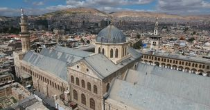 A drone flight a mosque on a city. A drone flight a mosque of Syria stock footage