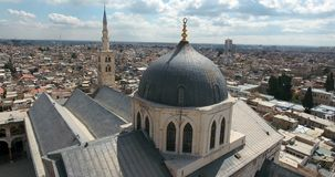 A drone flight a mosque on a city