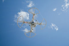 Drone in flight over the blue sky. Yebes, Spain - September 25, 2016: Drone taking images of the astronomy festival `expo astronomica` in the village of Yebes Stock Photography