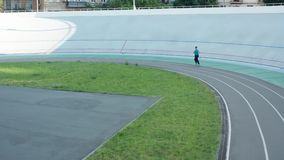 Drone shot of woman runner during workout on track