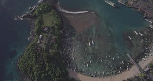 Drone flight over Padang Bay gorgeous ocean view including streets, ships, boats, beach in Bali, Indonesia. Drone flight over Padang Bay gorgeous ocean view stock video