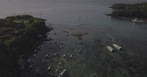 Drone flight over Padang Bay gorgeous ocean view including streets, ships, boats, beach in Bali, Indonesia. Drone flight over Padang Bay gorgeous ocean view stock video footage
